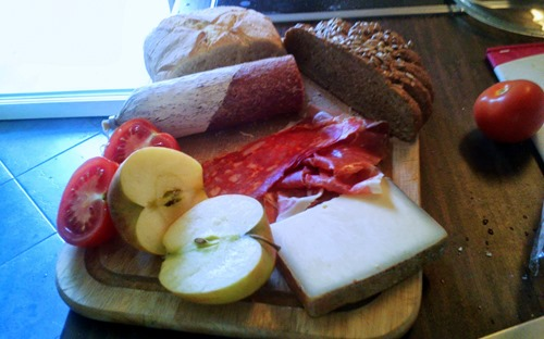 A Jausenbrettl: cured meats and cheeses, with a bread and a selection of fruit and veg on the side
