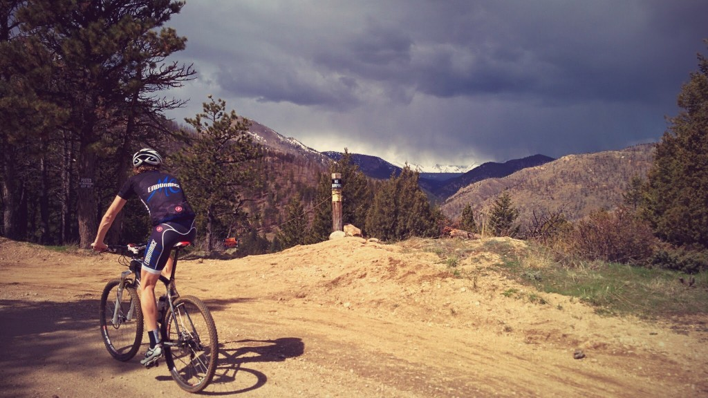 Chris Peterson rides up Logan Mill, an impending thunderstorm blocking the view up to the continental divide
