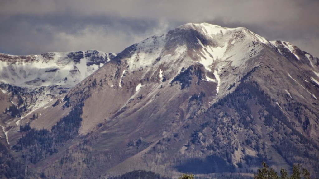 The fresh May snow coating the peaks