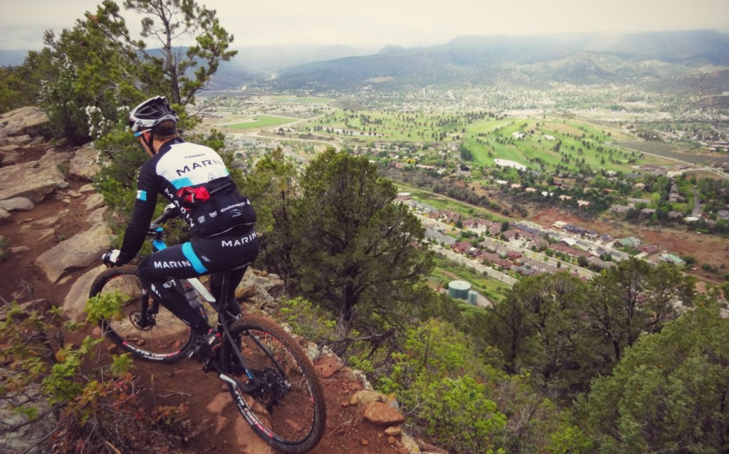 Bryan riding Raiders Ridge above downtown Durango. The rain made it an extra challenge