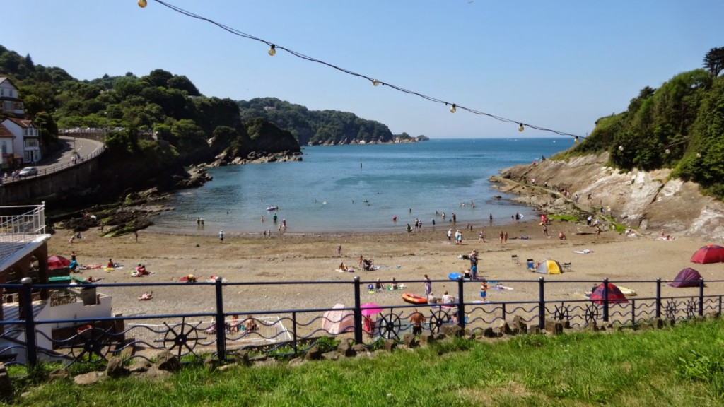 Combe Martin Beach in August. The sheltered cove and warm water means it's one of the best swimming beaches along the coast